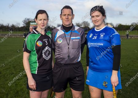 Stock Picture of Clanmaurice (Kerry) vs Raharney (Westmeath). Clanmaurice's Liz Houlihan with Referee Paul Ryan and Raharney's Rachel O'Malley