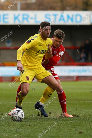 Ched Evans of Fleetwood Town and Jordan Tunnicliffe of Crawley Town during Crawley Town vs Fleetwood Town, Emirates FA Cup Football at Broadfield Stadium on 1st December 2019