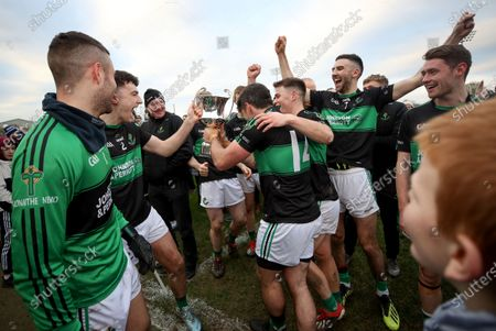 Clonmel Commercials vs Nemo Rangers . Nemo Ranger's Brian Murphy, Barry O'Driscoll, Kevin O'Donovan and Jack Horgan celebrate after the game with the Munster Senior Football Cup