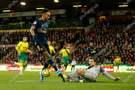 Pierre-Emerick Aubameyang of Arsenal is tackled by Norwich City goalkeeper Tim Krul