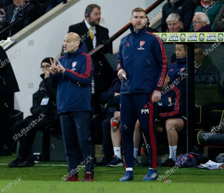 Freddie Ljunger the Arsenal interim manager with coach Per Mertesacker on the sidelines