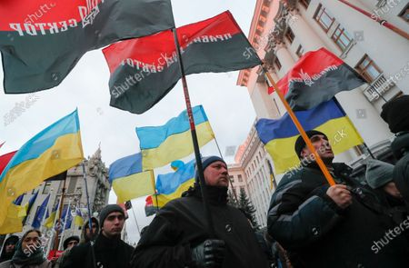 Activists and supporters of Ukrainian nationalist groups hold flags during a rally in front of the presidential office in Kiev, Ukraine, 01 December 2019. Activists gathered to mark anniversary of the first clashes protesters with police on 01 December 2013 during Euromaidan Revolution in Kiev and demanding to tear all diplomatic and economic relations with Russia. On 21 November 2013, activists started an anti-government picket after then-Prime Minister Mykola Azarov announced the suspension of a landmark treaty with the European Union. The protests eventually led to the ouster of President Viktor Yanukovych, creating political rifts through the country that erupted into a violent conflict between separatists and government forces in the eastern part of the country in the spring.