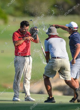 Pablo Larrazabal (L) of Spain celebrates winning the Dunhill Golf Championship at the Leopard Creek Golf Course, Nelspruit, South Africa, 01 December 2019.