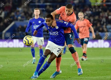 Leicester's Ricardo Pereira, left, duels for the ball with Everton's Richarlison during the English Premier League soccer match between Leicester City and Everton at the King Power Stadium in Leicester, England