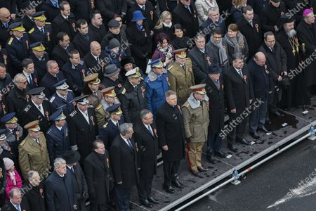 Romanian President Klaus Iohannis takes part in a military parade during Romania's National Day celebration