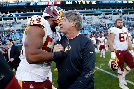 Washington Redskins linebacker Myles Humphrey (54) hugs head coach Bill Callahan following an NFL football game against the Carolina Panthers in Charlotte, N.C