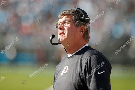 Washington Redskins head coach Bill Callahan looks on during the first half of an NFL football game against the Carolina Panthers in Charlotte, N.C