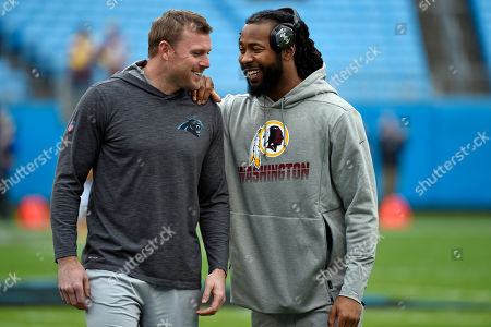 Carolina Panthers strong safety Colin Jones, left, and Washington Redskins cornerback Josh Norman chat prior to an NFL football game between the Carolina Panthers and the Washington Redskins in Charlotte, N.C