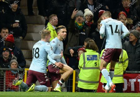 Aston Villa's Jack Grealish (C) reacts with team mates Matt Targett (L) and Conor Hourihane (R) after scoring the 1-0 lead during the English Premier League soccer match between Manchester United and Aston Villa at Old Trafford, Manchester, Britain, 01 December 2019.