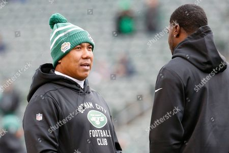 Stock Image of Hines Ward, A.J. Green. New York Jets offensive coordinator Hines Ward, left, speaks with Cincinnati Bengals wide receiver A.J. Green, right, during practice before an NFL football game, in Cincinnati