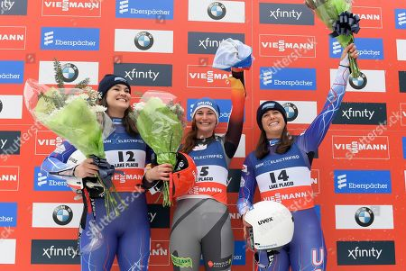 Stock Picture of From left, Summer Britcher, of the United States, Julia Taubitz of Germany, and Emily Sweeney, of the United States, celebrate after a sprint World Cup luge event in Lake Placid, N.Y., on . Taubitz finished first, Britcher, second, Sweeney, third