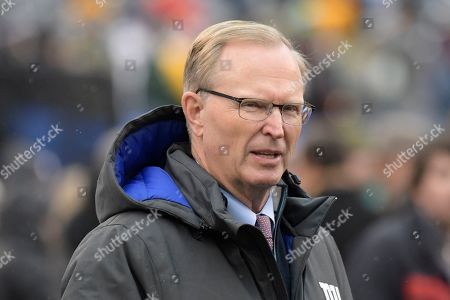 New York Giants owner John Mara walks on the field before an NFL football game against the Green Bay Packers, in East Rutherford, N.J