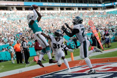 DeVante Parker, Jalen Mills, Rodney McLeod. Miami Dolphins wide receiver DeVante Parker (11) catches a pass for a touchdown as Philadelphia Eagles cornerback Jalen Mills (31) and free safety Rodney McLeod (23) attempt to defend, during the second half at an NFL football game, in Miami Gardens, Fla