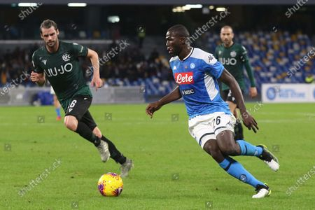Bolognas Andrea Poli (L) and  Napoli's Kalidou Koulibaly (R) in action during the Italian Serie A soccer match between SSC Napoli and Bologna FC at the San Paolo stadium in Naples,  01 December 2019.
