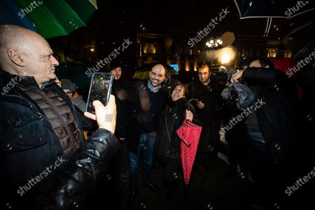Stock Image of Italian anti-mafia writer Roberto Saviano attends a rally staged by the anti-Salvini 'sardines' movement in Duomo Square, in Milan, northern Italy, 01 December 2019. A new grassroots movement called ' sardines' is fighting against Italy's rightwing strongman Matteo Salvini across the nation. The group is calling themselves 'sardines ' for how they pack squares around Italy.