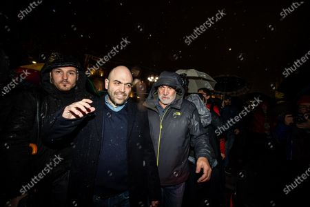 Italian anti-mafia writer Roberto Saviano attends a rally staged by the anti-Salvini 'sardines' movement in Duomo Square, in Milan, northern Italy, 01 December 2019. A new grassroots movement called ' sardines' is fighting against Italy's rightwing strongman Matteo Salvini across the nation. The group is calling themselves 'sardines ' for how they pack squares around Italy.