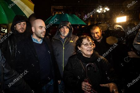 Stock Photo of Italian anti-mafia writer Roberto Saviano attends a rally staged by the anti-Salvini 'sardines' movement in Duomo Square, in Milan, northern Italy, 01 December 2019. A new grassroots movement called ' sardines' is fighting against Italy's rightwing strongman Matteo Salvini across the nation. The group is calling themselves 'sardines ' for how they pack squares around Italy.