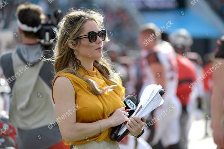 FOX Sports sideline reporter Jennifer Hale watches during the first half of an NFL football game between the Jacksonville Jaguars and the Tampa Bay Buccaneers, in Jacksonville, Fla