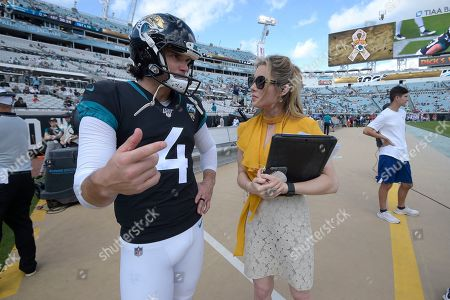 FOX Sports sideline reporter Jennifer Hale, right, talks with Jacksonville Jaguars kicker Josh Lambo (4) on the sideline before an NFL football game against the Tampa Bay Buccaneers, in Jacksonville, Fla