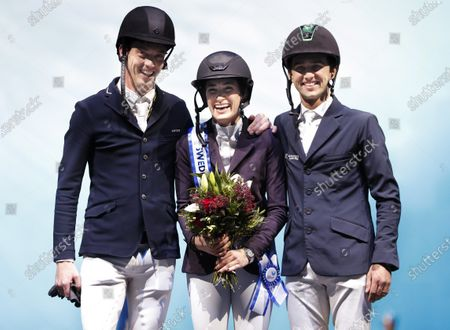 Silver medalist Harrie Smolders (NED) gold winner Jessica Springsteen (USA) and bronze medalist Marlon Modolo Zanotelli (BRA) celebrate on the podium after the grand prix jump competition at the Sweden International Horse Show in the Friends arena in Stockholm- Solna, Sweden, 01 December 2019.