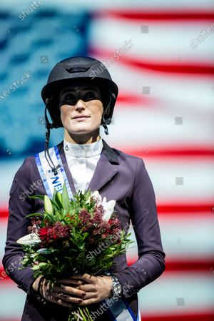 Winner Jessica Springsteen of the USA celebrates on the podium after the jump competition at the Sweden International Horse Show in the Friends arena in Stockholm- Solna, Sweden, 01 December 2019.