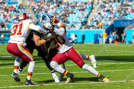 Carolina Panthers running back Christian McCaffrey (22) gets hit by Washington Redskins strong safety Landon Collins (20) in the NFL matchup at Bank of America Stadium in Charlotte, NC