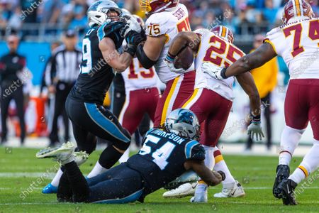 Carolina Panthers outside linebacker Shaq Thompson (54) goes for the hit on Washington Redskins running back Chris Thompson (25) in the NFL matchup at Bank of America Stadium in Charlotte, NC