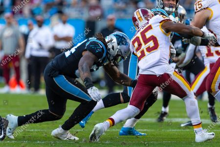Stock Picture of Carolina Panthers outside linebacker Shaq Thompson (54) goes for the hit on Washington Redskins running back Chris Thompson (25) in the NFL matchup at Bank of America Stadium in Charlotte, NC