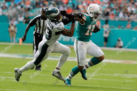 Albert Wilson, Rodney McLeod. Miami Dolphins wide receiver Albert Wilson (15) strong arms Philadelphia Eagles free safety Rodney McLeod Jr. (23), during the first half at an NFL football game, in Miami Gardens, Fla