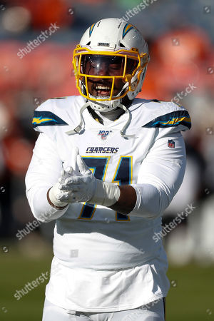 Los Angeles Chargers defensive end Damion Square watches during warm ups before an NFL football game against the Denver Broncos, in Denver