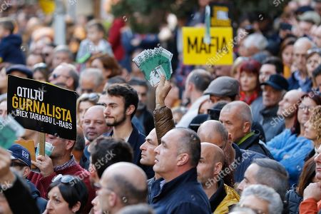 People stage a protest in La Valletta, Malta, . Malta's embattled prime minister has received a pledge of confidence from Labor Party lawmakers amid demands for his resignation by citizens angry over alleged links of his former top aide to the car bomb killing of a Maltese anti-corruption journalist. Hours later, thousands of Maltese protested outside a courthouse demanding that Joseph Muscat step down
