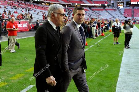 Los Angeles Rams owner Stan Kroenke, left, watches prior to an NFL football game abasing the Arizona Cardinals, in Glendale, Ariz