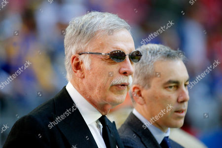 Los Angeles Rams owner Stan Kroenke watches his team prior to an NFL football game against the Arizona Cardinals, in Glendale, Ariz