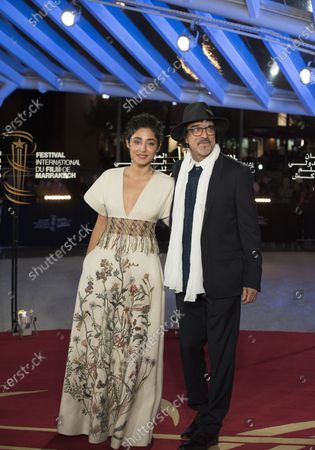 Golshifteh Farahani (L) and French writer Atiq Rahimi attend the tribute to French filmmaker Bertrand Tavernier (unseen) at the 18th annual Marrakech International Film Festival, in Marrakech, Morocco, 01 December 2019. The film festival runs from 29 November to 07 December 2019.