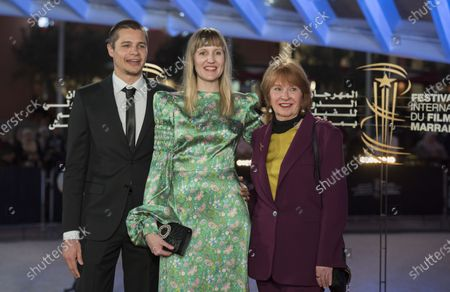Stock Photo of Shannon Murphy (C), British actor Toby Wallace (L) and guest attend the tribute to French filmmaker Bertrand Tavernier (unseen) at the 18th annual Marrakech International Film Festival, in Marrakech, Morocco, 01 December 2019. The film festival runs from 29 November to 07 December 2019.