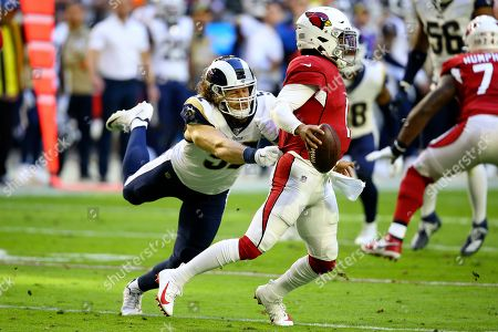 Arizona Cardinals quarterback Kyler Murray (1) is pressured by Los Angeles Rams outside linebacker Clay Matthews during the first half of an NFL football game, in Glendale, Ariz