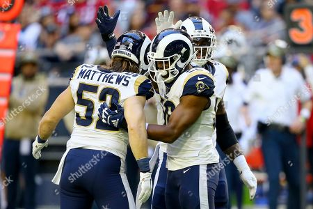 Los Angeles Rams defensive end Dante Fowler, center, celebrates his sack against the Arizona Cardinals with Los Angeles Rams outside linebacker Clay Matthews (52) during the first half of an NFL football game, in Glendale, Ariz