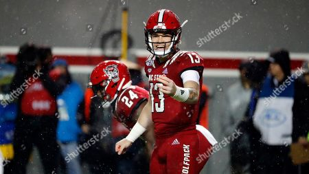 North Carolina State quarterback Devin Leary (13) changes a play against North Carolina during the first half of an NCAA college football game in Raleigh, N.C