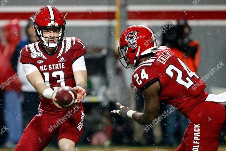 Devin Leary, Zonovan Knight. North Carolina State's Devin Leary (13) hands the ball off to Zonovan Knight (24) against North Carolina during the first half of an NCAA college football game in Raleigh, N.C