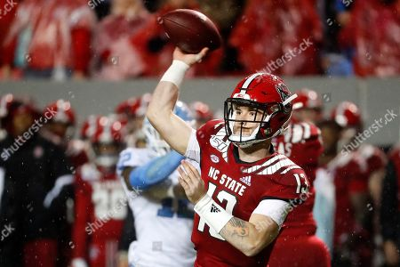 North Carolina State quarterback Devin Leary (13) throws the ball against North Carolina during the first half of an NCAA college football game in Raleigh, N.C