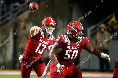 Grant Gibson, Devin Leary. North Carolina State's Grant Gibson (50) gives quarterback Devin Leary (13) time to throw the ball against against North Carolina during the first half of an NCAA college football game in Raleigh, N.C