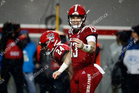 North Carolina State quarterback Devin Leary (13) changes the play prior to a snap against North Carolina State during the first half of an NCAA college football game in Raleigh, N.C