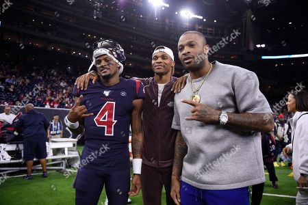 Houston Texans quarterback Deshaun Watson (4) poses with Houston Rockets players Russell Westbrook, center, and P.J. Tucker, right, before an NFL football game =aNew England Patriots, in Houston