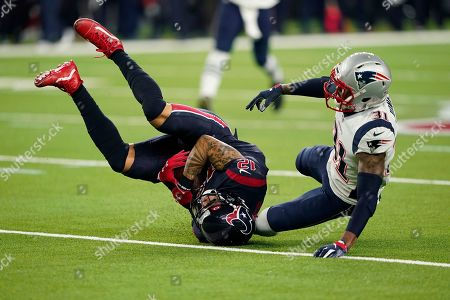 Houston Texans wide receiver Kenny Stills (12) makes a catch in front of New England Patriots cornerback Jonathan Jones (31) during the second half of an NFL football game, in Houston