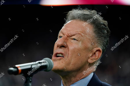 Stock Picture of Lyle Lovett signs the national anthem before an NFL football game between the Houston Texans and the New England Patriots, in Houston