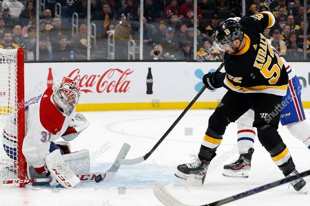 Montreal Canadiens goaltender Carey Price stops Boston Bruins' Sean Kuraly at the crease during the second period of an NHL hockey game, in Boston