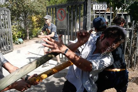Neighbors attack protesters protesting near the house of the president of Chile Sebastian Pinera, during his birthday, in the commune of Las Condes, an affluent neighborhood in Santiago, Chile, 01 December 2019. The protests in Chile, which began in response to an increase in metro fares, morphed into a broad movement demanding greater redistribution of wealth and government provision of free basic services.