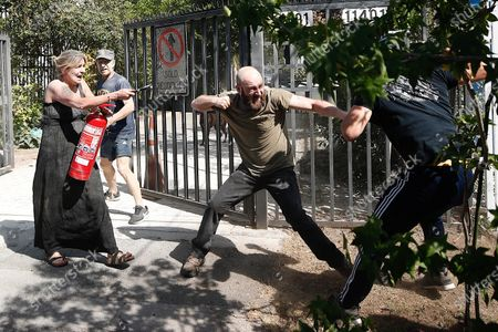 Neighbors attack demostrators protesting near the house of the president of Chile Sebastian Pinera, during his birthday, in the commune of Las Condes, an affluent neighborhood in Santiago, Chile, 01 December 2019. The protests in Chile, which began in response to an increase in metro fares, morphed into a broad movement demanding greater redistribution of wealth and government provision of free basic services.