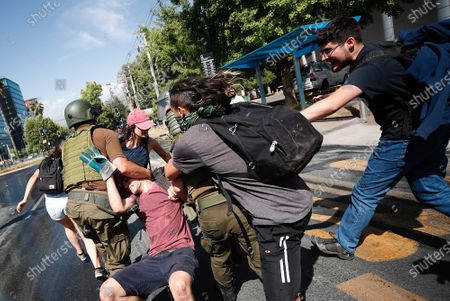 Special Forces soldiers detain a protester near the house of the president of Chile Sebastian Pinera, during his birthday, in the commune of Las Condes, an affluent neighborhood in Santiago, Chile, 01 December 2019. The protests in Chile, which began in response to an increase in metro fares, morphed into a broad movement demanding greater redistribution of wealth and government provision of free basic services.