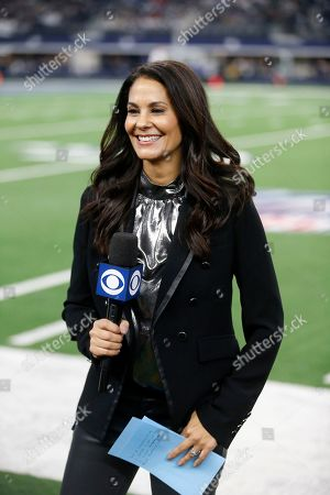CBS reporter Tracy Wolfson reports from the sideline during an NFL football game between the Buffalo Bills and Dallas Cowboys in Arlington, Texas